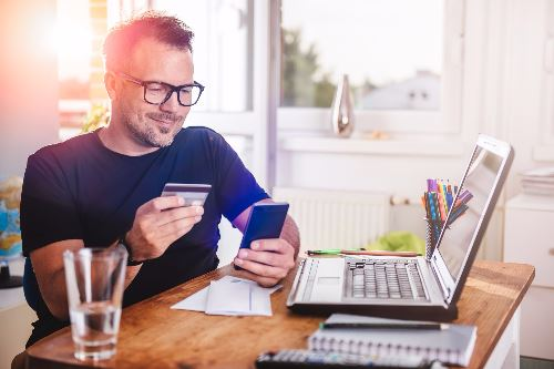 Man using mobile to access banking
